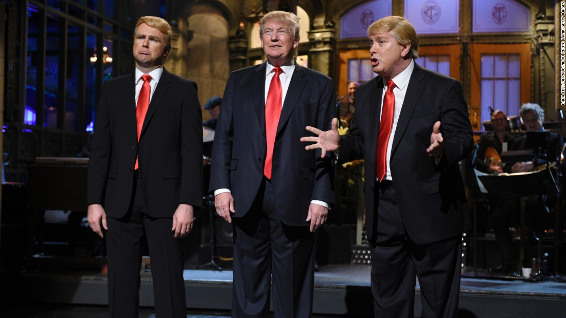 "Republican presidential candidate Donald Trump is flanked by impersonators Taran Killam, left, and Darrell Hammond during his <a href=""http://money.cnn.com/2015/11/08/media/donald-trump-saturday-night-live-snl-host/"" target=""_blank"">""Saturday Night Live"" monologue</a> on November 7."