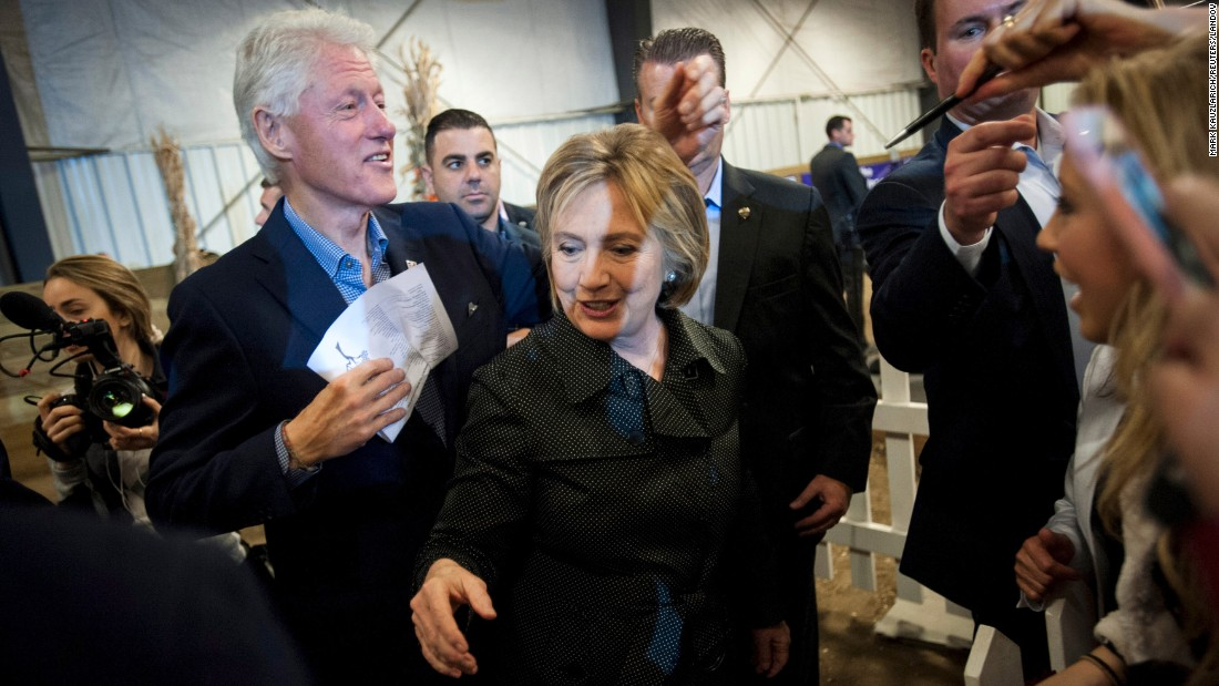 Democratic presidential candidate Hillary Clinton and her husband, former U.S. President Bill Clinton, greet supporters at a barbecue event in Ames, Iowa, on Sunday, November 15.