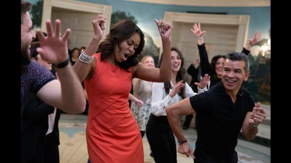 First lady Michelle Obama dances to Gloria Estefan