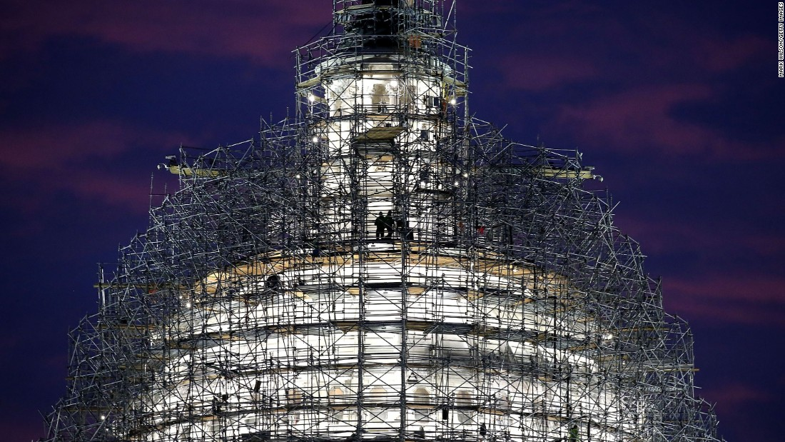 Workers stand on the scaffolding that surrounds the dome of the U.S. Capitol building on Tuesday, November 17. The dome is being renovated.