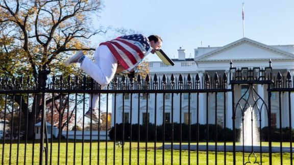 A man jumps a fence at the White House on Thursday, November 26. He was immediately apprehended and taken into custody, the Secret Service said.