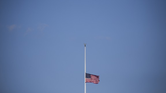 The American flag flies at half-staff above the White House on Thursday, December 3. President Obama signed a proclamation for all flags to be flown at half-staff to honor the victims of a mass shooting in San Bernardino, California.