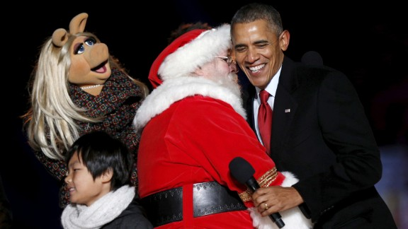President Obama hugs Santa Claus near Muppets character Miss Piggy during the National Christmas Tree Lighting in Washington on Thursday, December 3.