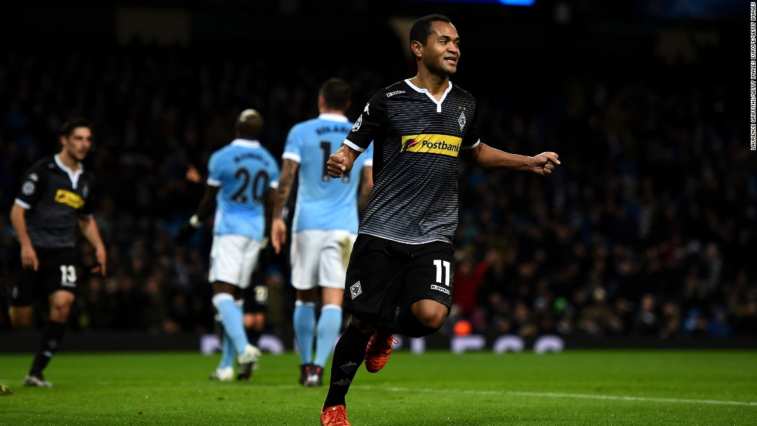 Raffael of Borussia Moenchengladbach celebrates scoring his side's second goal during the UEFA Champions League Group D match between Manchester City and Borussia Monchengladbach at the Etihad Stadium.