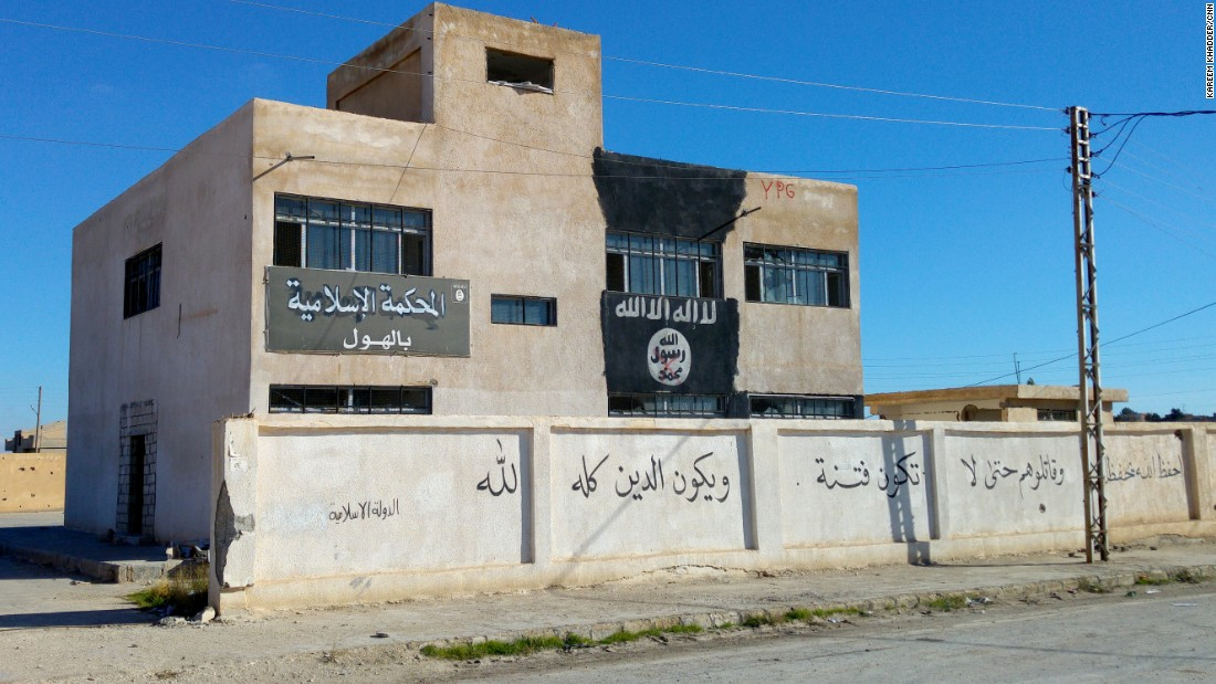 "ISIS' courthouse in Al-Houl, previously a school. The building also housed offices for an ISIS charity, with empty boxes marked ""shoes"" sent from an Islamic charity in Durban, South Africa."