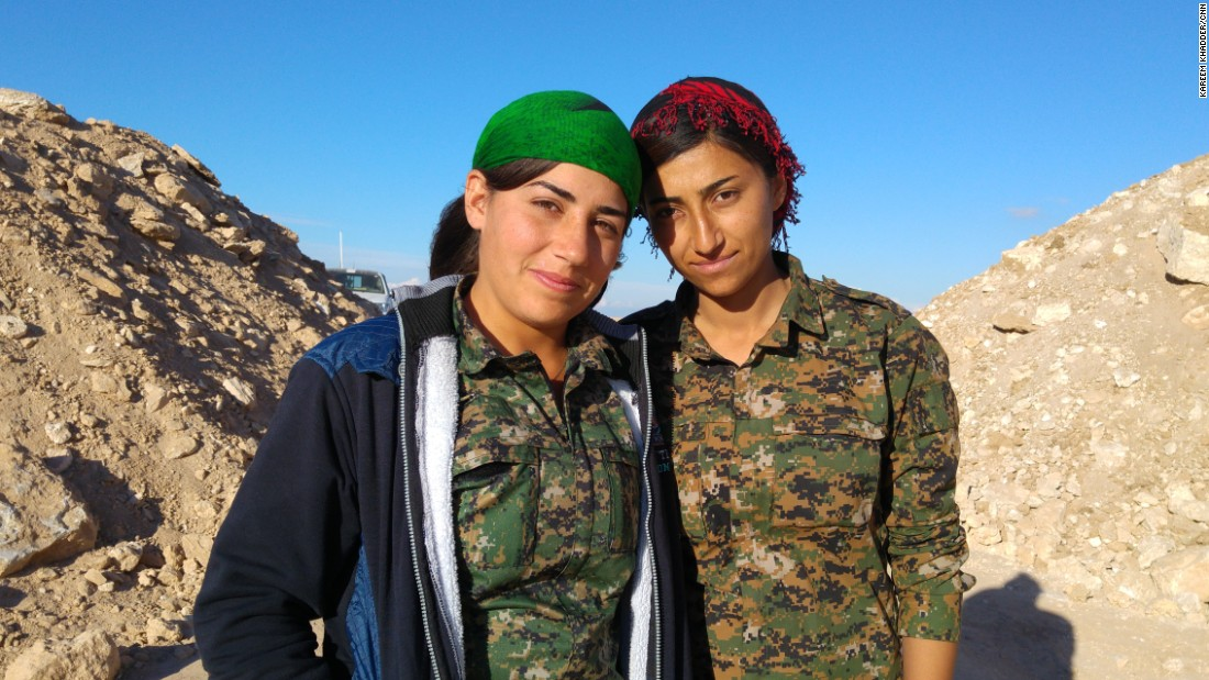 "Two members of the YPK, the Kurdish ""Women's Defence Units,"" on the front lines south of Al-Houl, in Al-Hassakeh province."