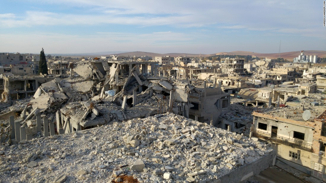 The view from Hammouda's pigeon perch. The reconstruction effort in Kobani has come to a screeching halt after Turkey closed its border, depriving the town of the building materials it desperately needs.