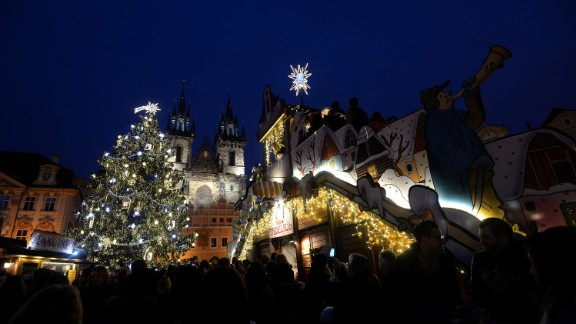 An illuminated tree lights the market at the Old Town Square in Prague, Czech Republic.