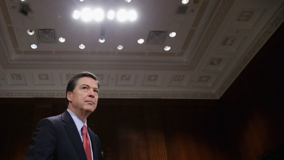 Federal Bureau of Investigation Director James Comey prepares to testify before the Senate Judicary Committee in the Dirksen Senate Office Building on Capitol Hill December 9, 2015 in Washington, D.C.