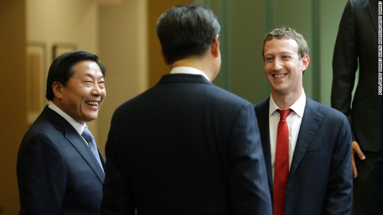 Chinese President Xi Jinping (middle) talks with Facebook Chief Executive Mark Zuckerberg (right) as Lu Wei, China's Internet czar, looks on during a gathering of CEOs and other executives at the main campus of Microsoft Corp September 23, 2015  in Redmond, Washington.