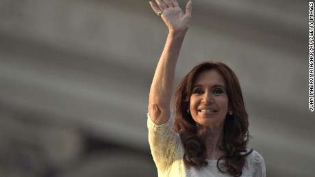 Argentine President Cristina Fernandez de Kirchner waves after unveiling a sculpture of late Argentine President (2002-2007) Nestor Kirchner at Government Palace in Buenos Aires on December 9, 2015. Opposition Mauricio Macri will take on office Thursday as new Argentina president.    AFP PHOTO / JUAN MABROMATA / AFP / JUAN MABROMATA        (Photo credit should read JUAN MABROMATA/AFP/Getty Images)