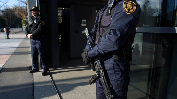 Security forces stand guard at the entrance of the United Nations headquarter in Geneva on December 10, 2015 after Swiss police declared actively searching the city for suspects who may be linked to last month