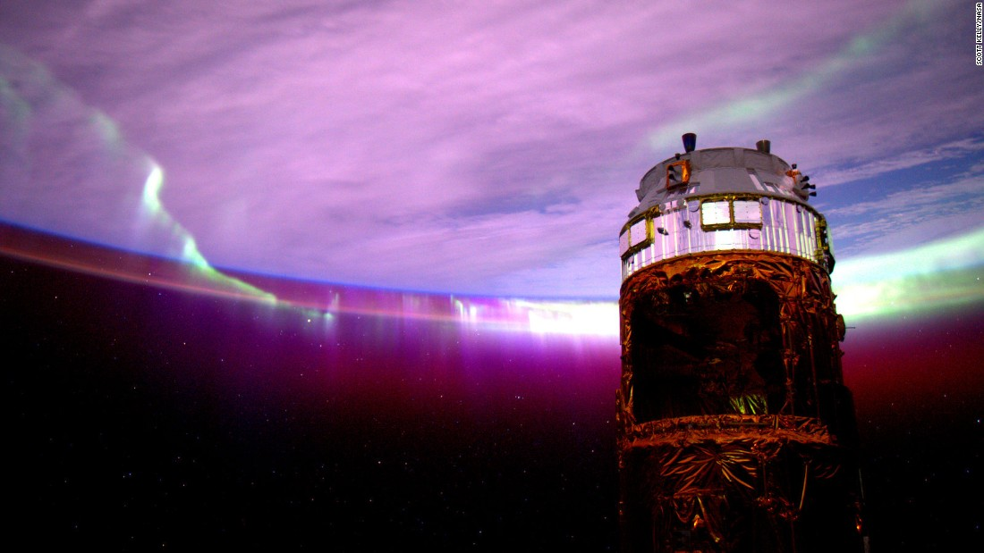 "August 27: ""Day 154. #Aurora's purple glow adds mystery to the nightscape. Good night from @ISS!"""