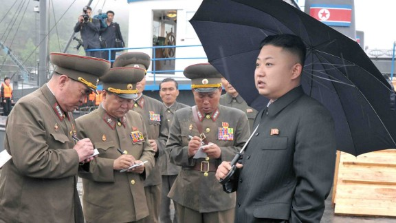 """This undated picture released by North Korea's official Korean Central News Agency (KCNA) on May 28, 2013 shows North Korean leader Kim Jong-Un (R, front) inspecting the August 25 Fishery Station under the Korean People's Army (KPA) Unit 313.   AFP PHOTO / KCNA via KNS    THIS PICTURE WAS MADE AVAIALBLE BY A THIRD PARTY. AFP CAN NOT INDEPENDENTLY VERIFY THE AUTHENTICITY, LOCATION, DATE AND CONTENT OF THIS IMAGE. THIS PHOTO IS DISTRIBUTED EXACTLY AS RECEIVED BY AFP. AFP PHOTO / KCNA via KNS ---EDITORS NOTE--- RESTRICTED TO EDITORIAL USE - MANDATORY CREDIT """"AFP PHOTO / KCNA VIA KNS"""" - NO MARKETING NO ADVERTISING CAMPAIGNS - DISTRIBUTED AS A SERVICE TO CLIENTS ---        (Photo credit should read KCNA/AFP/Getty Images)"""