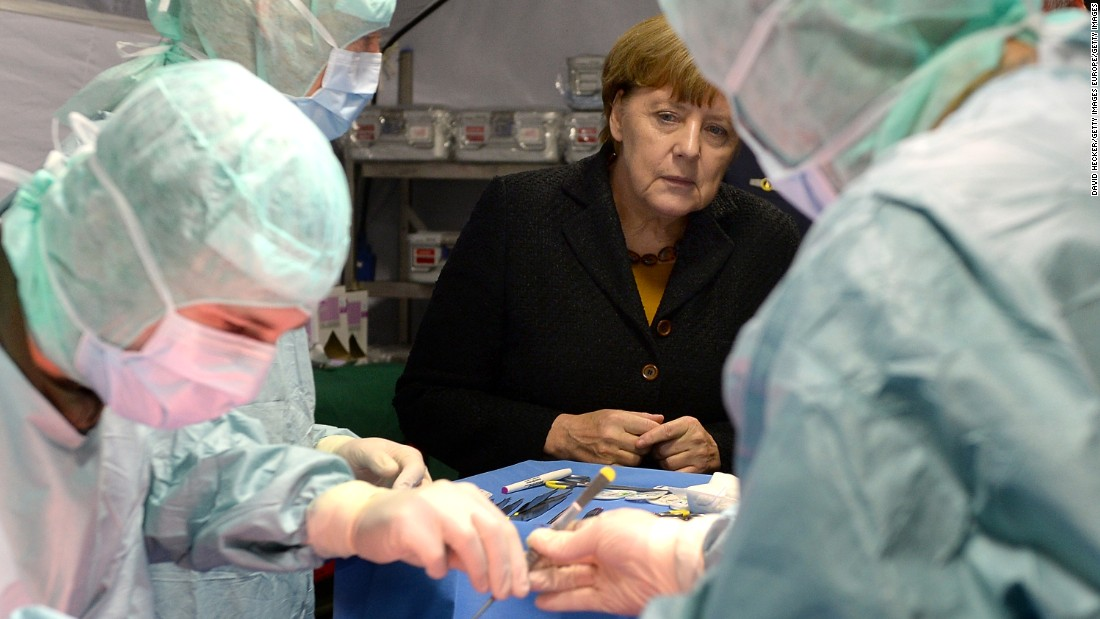"German Chancellor Angela Merkel chats with members of the German military's rapid-reaction medical unit during a visit to its training center in Leer, Germany, on Monday, December 7. Merkel has been named <a href=""http://www.cnn.com/2015/12/09/europe/time-person-of-the-year-merkel/"" target=""_blank"">Time magazine's Person of the Year.</a>"