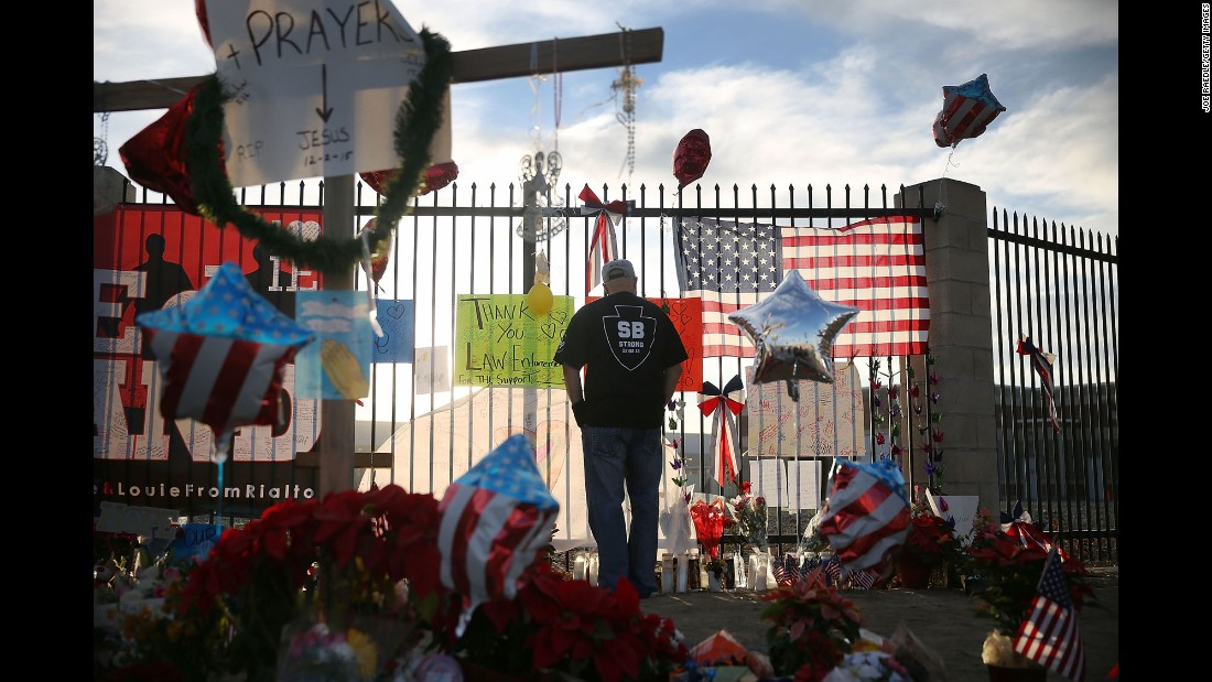 "A man visits a makeshift memorial Monday, December 7, for those killed in <a href=""http://www.cnn.com/2015/12/02/us/gallery/san-bernardino-shooting/index.html"" target=""_blank"">a mass shooting in San Bernardino, California.</a> The shooting took place at the Inland Regional Center, where employees with the county health department were attending a holiday event. The two shooters -- Syed Rizwan Farook and his wife, Tashfeen Malik -- were fatally shot in a gun battle with police hours after the initial incident."