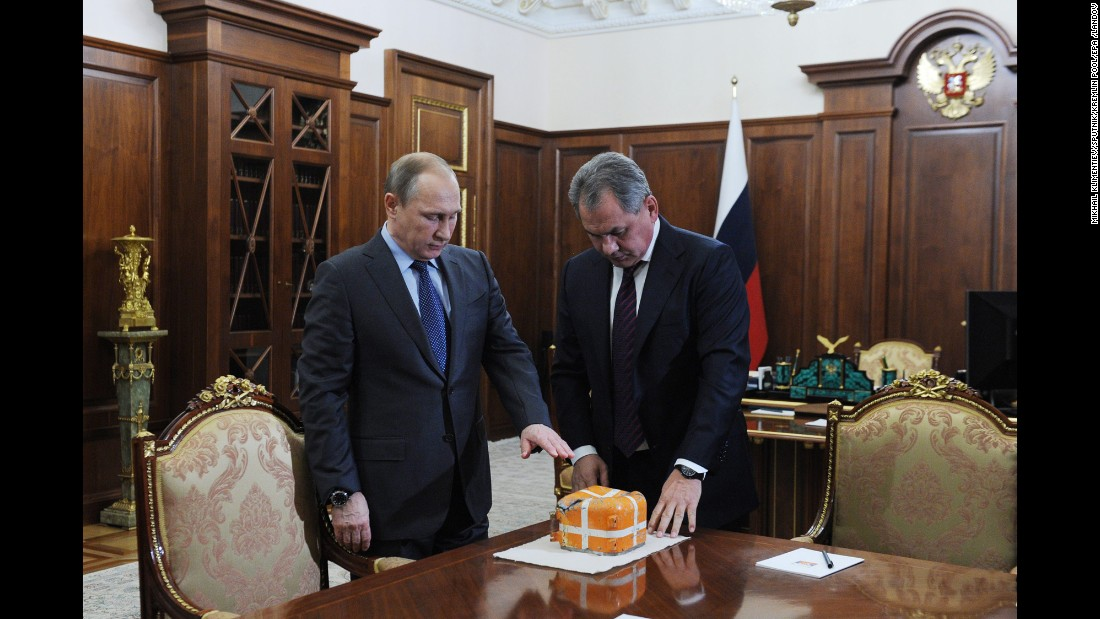 "Russian Defense Minister Sergei Shoigu, right, presents President Vladimir Putin with the flight recorder of the Russian fighter jet <a href=""http://www.cnn.com/2015/11/24/middleeast/russia-turkey-jet-downed-syria/"" target=""_blank"">that was shot down by Turkey last month.</a>"