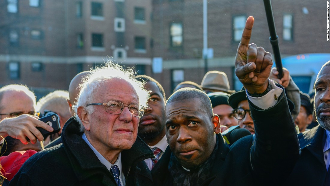 "Pastor Jamal Bryant points something out to U.S. Sen. Bernie Sanders on Tuesday, December 8, as the presidential candidate <a href=""http://www.cnn.com/2015/12/08/politics/bernie-sanders-freddie-gray-baltimore-2016/"" target=""_blank"">toured the Baltimore neighborhood</a> where violence erupted after the death of Freddie Gray earlier this year. Gray, 25, died in police custody in April. According to his attorney, he died from a severe spinal cord injury he received while in police custody. The case raised long-simmering tensions between police and residents, and six police officers have been charged in connection with Gray's death."