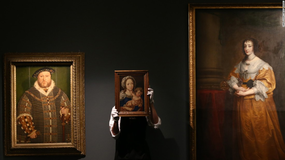 "A Sotheby's staff member in London holds ""Mabuse,"" a painting by Jan Gossaert, during a press preview of artwork on Friday, December 4. The Gosseart piece was expected to bring in more than $6 million at auction."