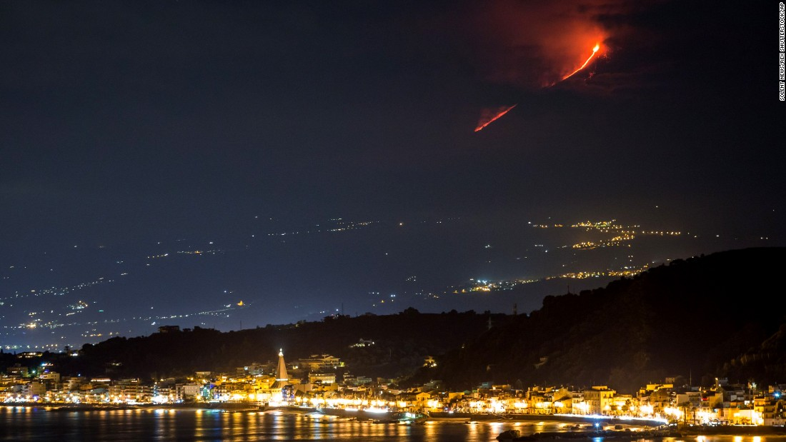 Volcanic ash fills the sky Friday, December 4, during an eruption of Mount Etna in Sicily, Italy. Experts called it the volcano's most dramatic eruption in 20 years.