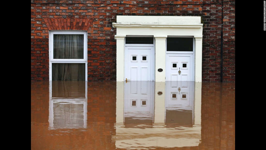 "Homes in Carlisle, England, are submerged by floodwaters on Monday, December 7. Storm Desmond <a href=""http://www.cnn.com/2015/12/07/europe/uk-flooding/"" target=""_blank"">dumped record levels of rain</a> on northern England and Scotland over the weekend, flooding areas of Cumbria and Lancashire counties and prompting authorities to call in the armed forces to help evacuate."