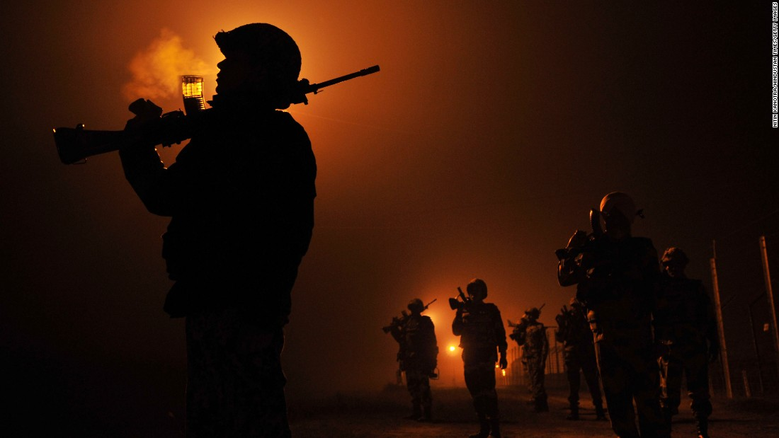"Border security troops patrol the area near Jammu, India, on a foggy night Saturday, December 5. <a href=""http://www.cnn.com/2015/12/04/world/gallery/week-in-photos-1204/index.html"" target=""_blank"">See last week in 38 photos</a>"