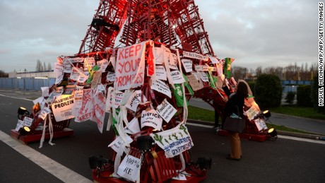 An Eiffel Tower made of bistro chairs is seen covered in messages related to climate change at COP21, the United Nations conference on climate change in Le Bourget, France.