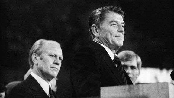 American president Gerald Ford (left) listens as future American president Ronald Reagan (1911 - 2004) delivers a speech during the closing session of the Republican National Convention on August 19, 1976 in Kansas City, Missouri.