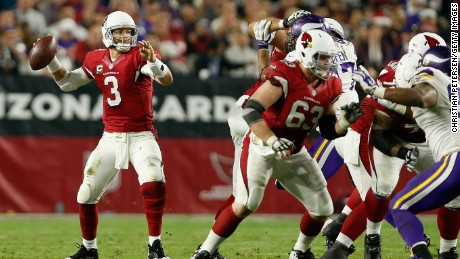 Quarterback Carson Palmer #3 of the Arizona Cardinals drops back to pass during the NFL game against the Minnesota Vikings at the University of Phoenix Stadium on December 10, 2015 in Glendale, Arizona. The Cardinals defeated the Vikings 23-20.