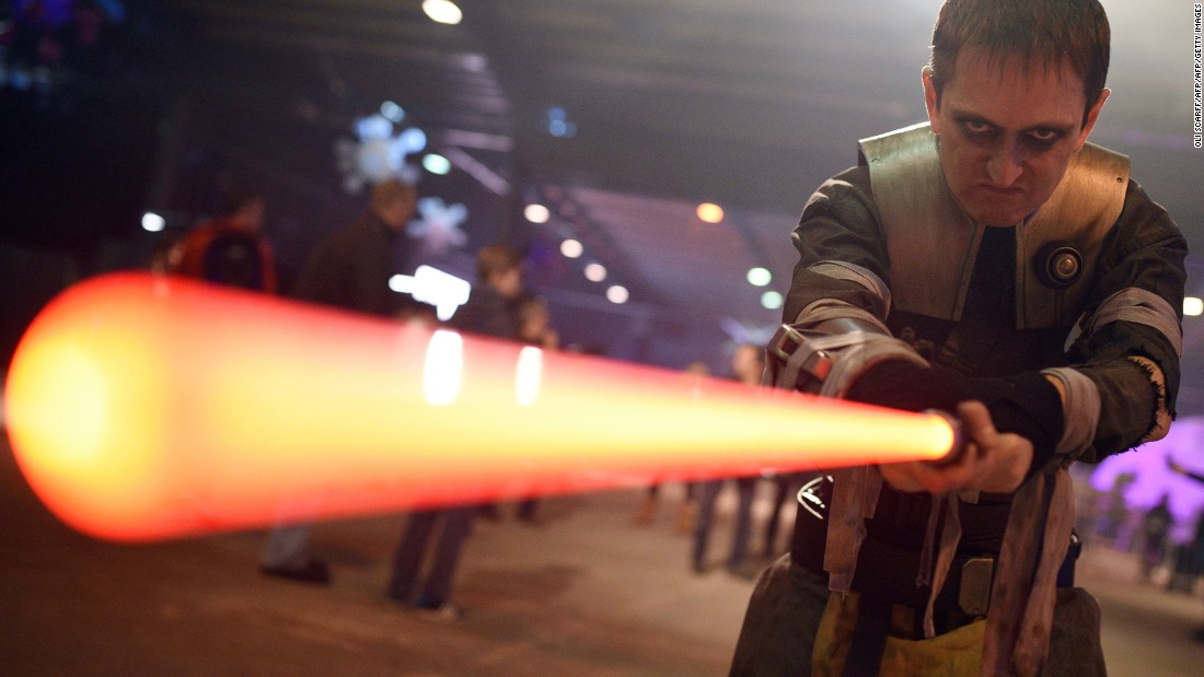 A performer dressed as the Star Wars character Galen Marek, brandishes a lightsaber during the unofficial Star Wars convention, 'For the Love of the Force,' in Manchester, northern England on December 4, 2015.
