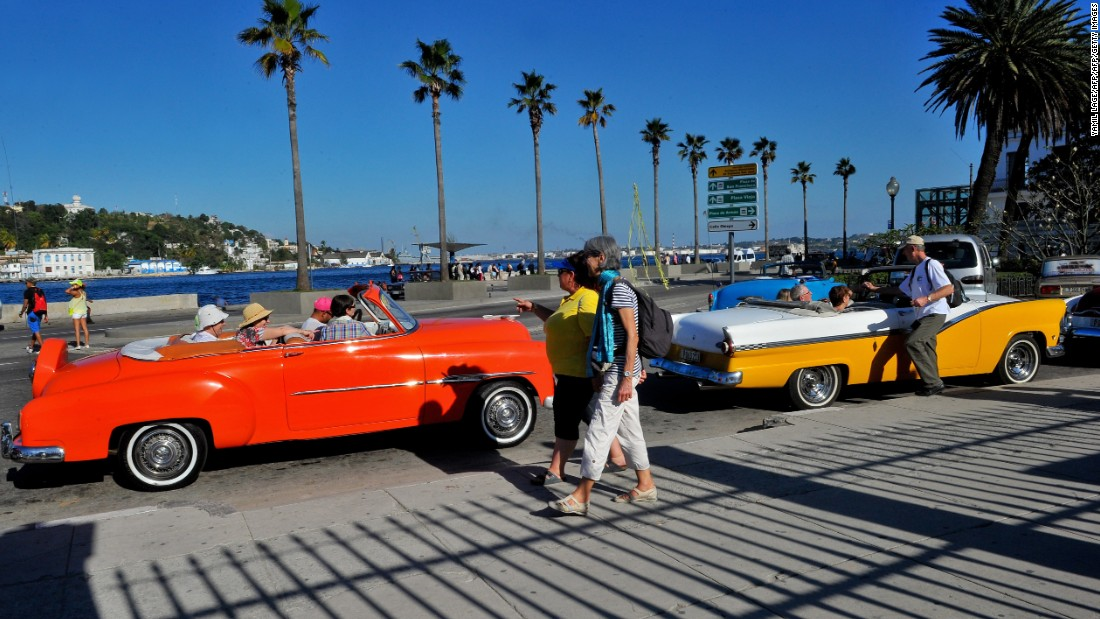 U.S. tourists crowd into old American cars in Havana. Cuba is scrambling to accommodate an influx of visitors.