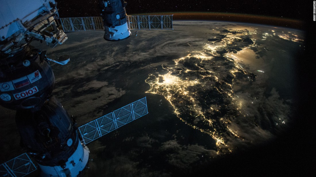 "July 25: ""#Goodevening #Japan. Showing @Astro_Kimiya how to take pictures of #Earth at night."""