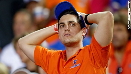 GAINESVILLE, FL - OCTOBER 18: A Florida Gators fan reacts at the end of the first half of the game between the Florida Gators and the Missouri Tigers at Ben Hill Griffin Stadium on October 18, 2014 in Gainesville, Florida. Missouri lead Florida 20-0 at the half. (Photo by Rob Foldy/Getty Images)