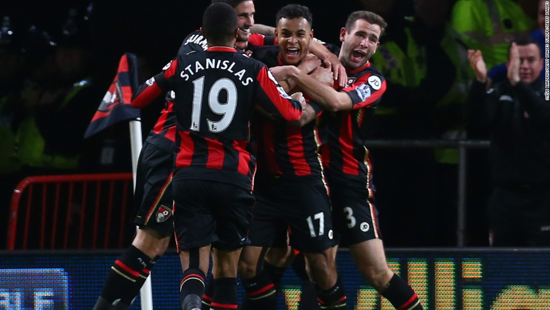 Joshua King (second right) is mobbed by teammates after scoring his team's vital second goal in the 2-1 victory over Manchester United.