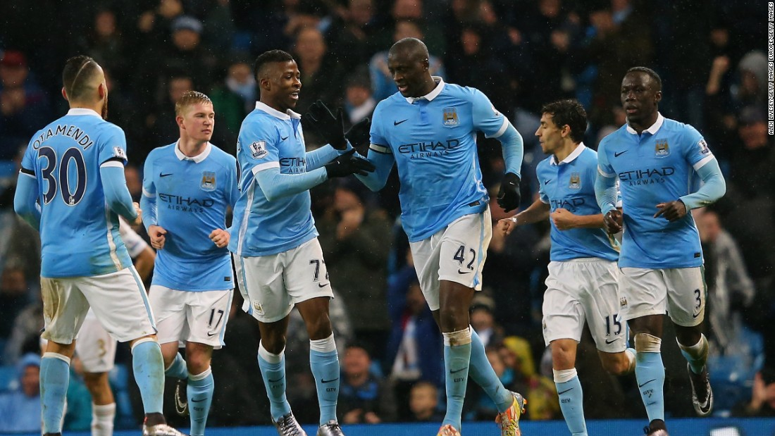 Yaya Toure takes the plaudits after his late shot was deflected home to give Manchester City a 2-1 win over Swansea at the Etihad Stadium.