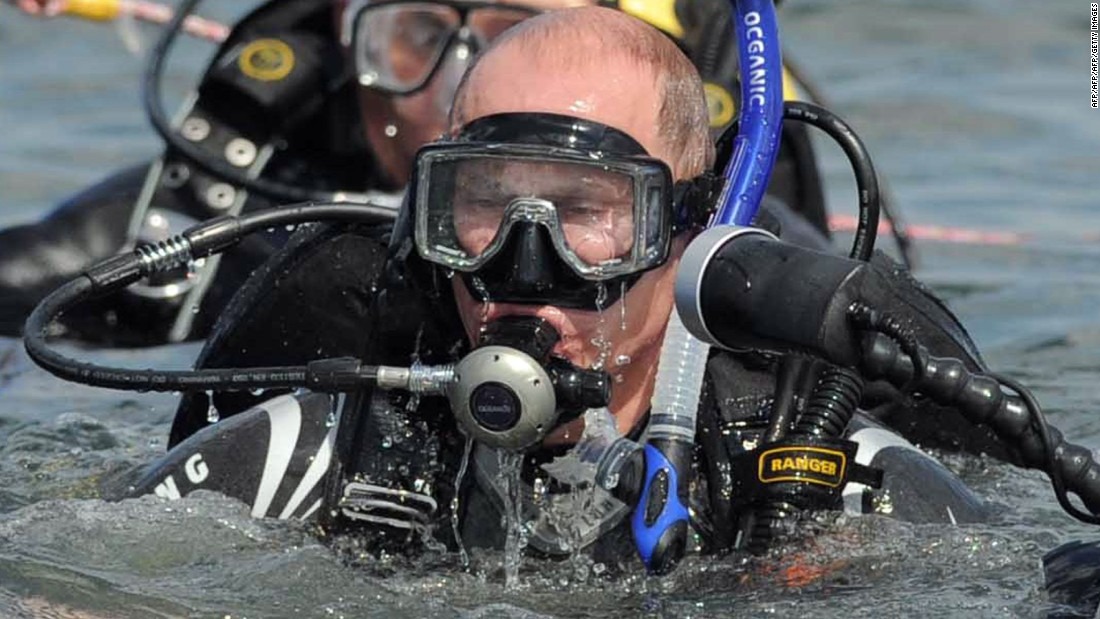Putin is a regular all-action hero - here he is pictured scuba diving.