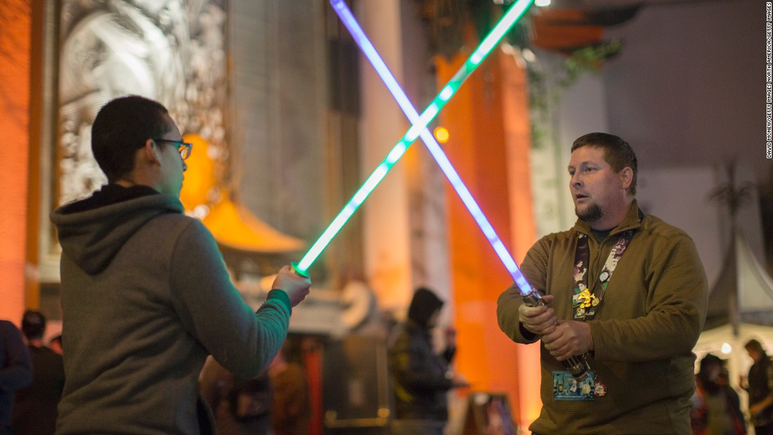 More fans practice their lightsaber fighting technique as they camp out in the TLC Chinese Theatre courtyard.