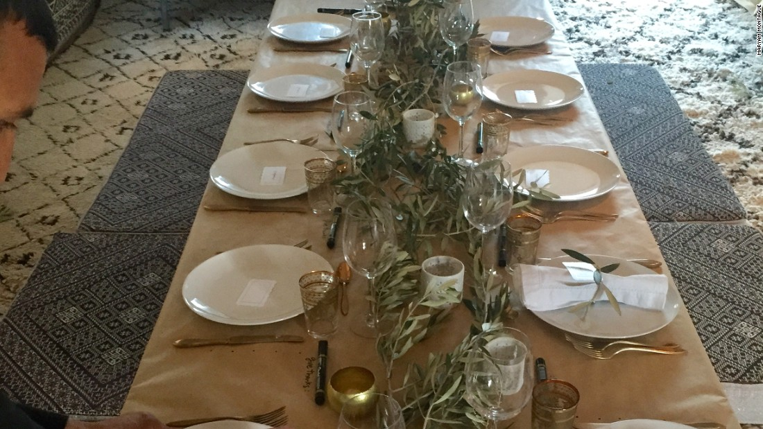 To encourage her guests to give thanks, and write down their thoughts, Montague sets the table with a craft paper tablecloth and provides a pen.<br />The only other decorations are olive branches and candles.