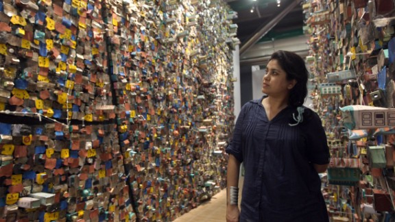 "Indian artist Hema Upadhyay poses in front of her ""Think Left, Think Right, Think Low, Think Tight"" installation at the Paris's Pompidou Centre on May 23, 2011."
