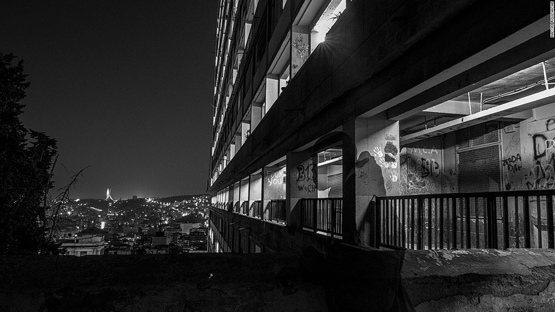 """The series is shot at the Aero-Habitat, a quarter in the Algerian capital that looks like a vertical village. This community of migrants has chosen to inhabit this building because it gives them a living space, a place to work but also a hiding place. They can live here without exposure to the risk of identity checks that happen in the outside world,"" explains Rouchiche."