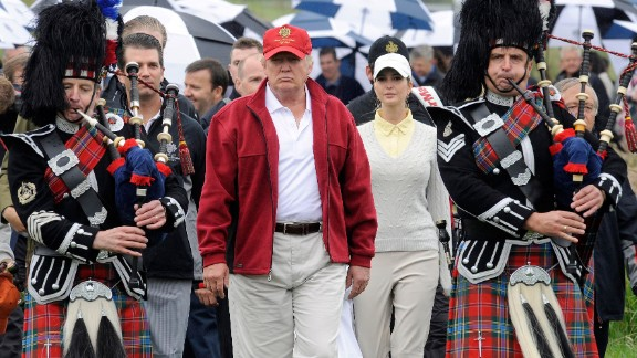 (FILES) A picture taken on July 10, 2012 shows US tycoon Donald Trump (C) escorted by Scottish pipers as he officially opens his new multi-million pound Trump International Golf Links course in Aberdeenshire, Scotland. Over 70,000 people had on December 9, 2015 signed a petition to ban US presidential hopeful Donald Trump from entering Britain following his call to bar Muslims from entering the United States. AFP PHOTO / Andy BuchananAndy Buchanan/AFP/Getty Images