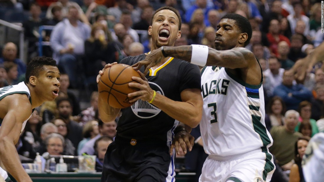 Golden State star Stephen Curry is guarded by O.J. Mayo during an NBA game in Milwaukee on Saturday, December 12. Mayo and the Bucks handed the Warriors their first loss of the season, dropping the defending champions to 24-1. It was the league's best-ever start.