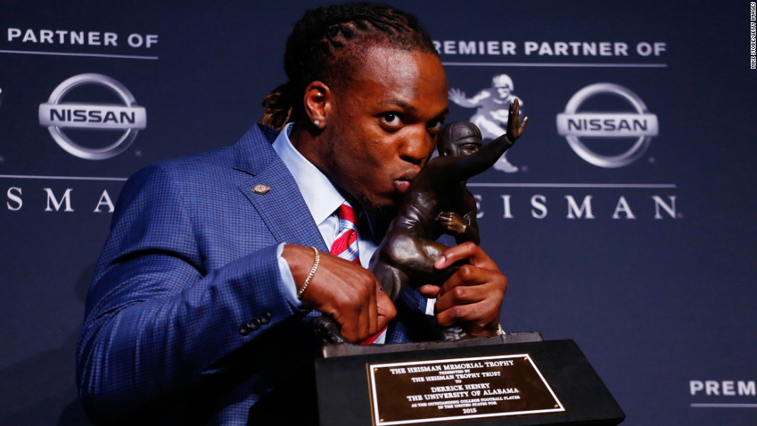 "Alabama running back Derrick Henry kisses <a href=""http://www.cnn.com/2015/12/12/us/heisman-trophy/"" target=""_blank"">his Heisman Trophy</a> on Saturday, December 12. Henry rushed for 1,986 yards this season, breaking Herschel Walker's SEC record."