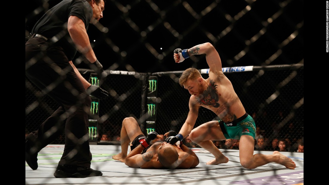 "Conor McGregor punches Jose Aldo during their <a href=""http://bleacherreport.com/articles/2598679-ufc-194-results-technical-breakdown-of-aldo-mcgregor-and-weidman-rockhold"" target=""_blank"">UFC featherweight title fight</a> in Las Vegas on Saturday, December 12. McGregor knocked Aldo out in 13 seconds -- a UFC record for a title fight -- handing the champion his first loss in 10 years."