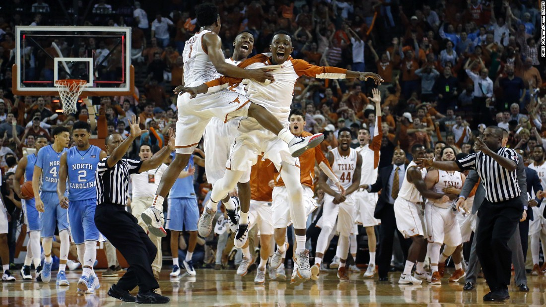 Texas basketball players celebrate after a buzzer-beater by Javan Felix gave them an 84-82 victory over North Carolina on Saturday, December 12.