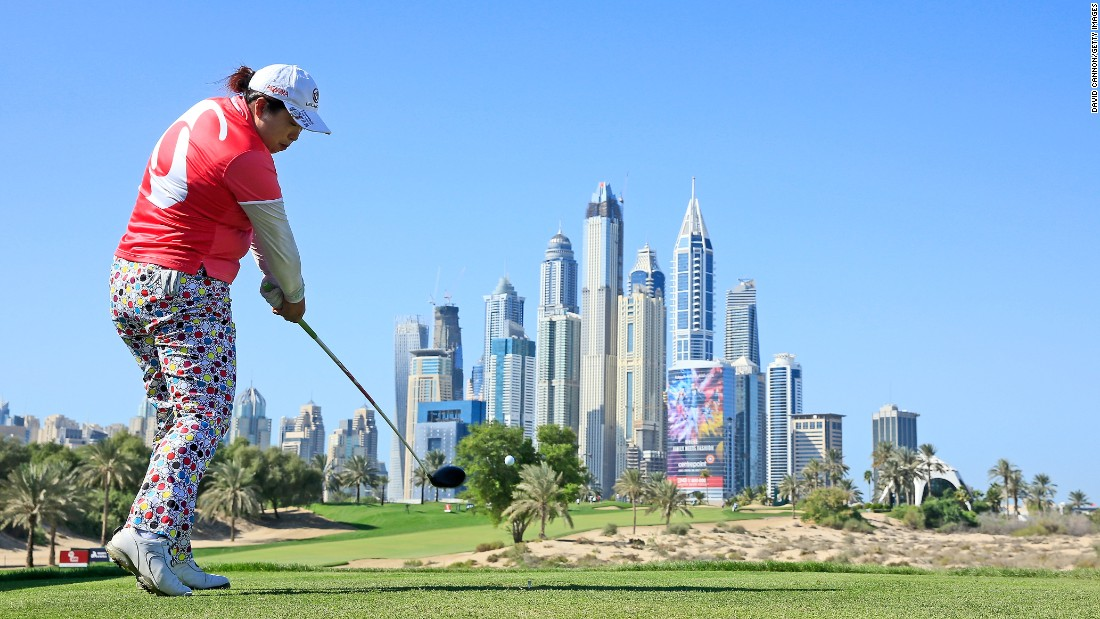 Shanshan Feng hits a tee shot Thursday, December 10, during the second round of the Dubai Ladies Masters, an event on the Ladies European Tour. Feng blew away the field, winning by 12 strokes.