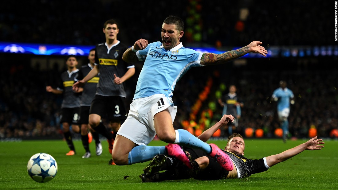 Manchester City's Aleksandar Kolarov is tackled by Nico Elvedi of Borussia Moenchengladbach during a Champions League match in Manchester, England, on Tuesday, December 8.