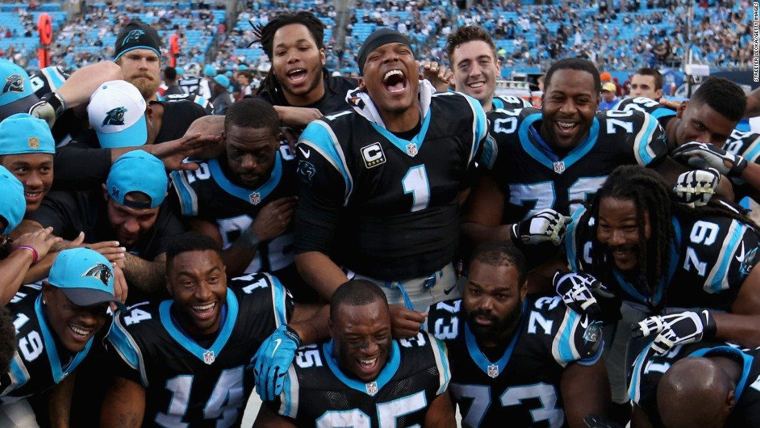 Cam Newton (No. 1) and the Carolina Panthers celebrate Sunday, December 13, after they shut out Atlanta 38-0 to clinch a first-round playoff bye. The Panthers (13-0) are the NFL's only undefeated team this season.