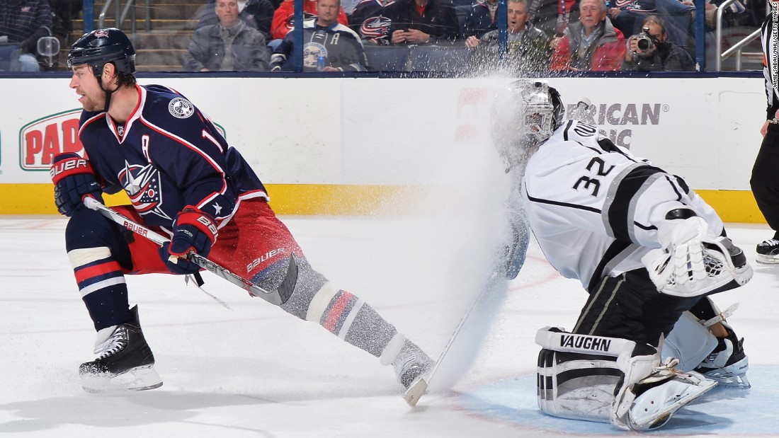Columbus forward Brandon Dubinsky sprays ice into the face of Los Angeles goaltender Jonathan Quick during an NHL game in Columbus, Ohio, on Tuesday, December 8.