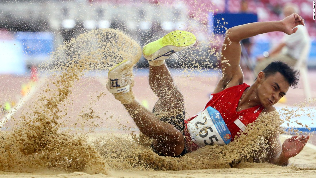 Singapore's Suhairi Suhani lands in the sand pit after a long jump at the ASEAN Para Games on Tuesday, December 8. He won silver in the event.